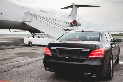 What are the benefits of hiring a car service for airport transportation?